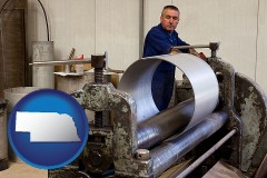 nebraska map icon and a sheet metal worker fabricating a metal tube
