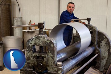 a sheet metal worker fabricating a metal tube - with Delaware icon
