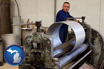 a sheet metal worker fabricating a metal tube - with Michigan icon