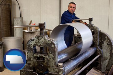 a sheet metal worker fabricating a metal tube - with Nebraska icon