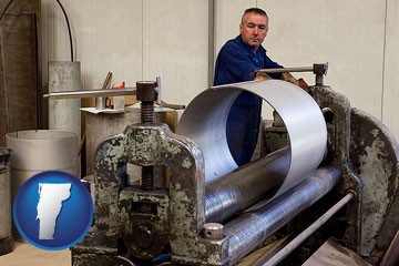 a sheet metal worker fabricating a metal tube - with Vermont icon