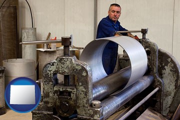 a sheet metal worker fabricating a metal tube - with Wyoming icon